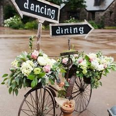 reception decor, bike with florals and chalk signs