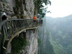 These are the Cliffside Steps in Hunan, China. Among the most dangerous paths in the world, it is located in the south central part of the Chinese mainland. Hunan's mixture of mountains and water makes it among the most beautiful provinces in China. Places Around The World, The Places Youll Go, Places To See, Around The Worlds, Machu Picchu, Dangerous Roads, Beautiful Landscapes, Wonders Of The World, Places To Travel