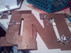 My sister Tonis letters i made for her room for xmas. You cant tell from the picture but the gold is metallic.. :-)