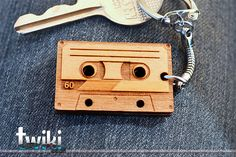 Laser cut and engraved Audio Cassette wood keyring. By TwikiConcept on Etsy
