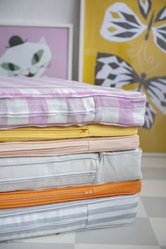 Colours are fun. Mattress covers by Bemz in Gotland Stripe Grey/White, Mandarin Orange, Paler Shade of Grey, Peach, Sun Yellow and Quadretto Blossom. www.bemz.com