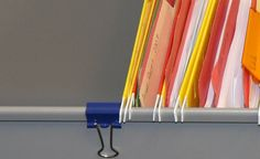 This is such a simple idea, I cant believe I never thought of it before seeing this photo! Use a binder clip to prevent hanging files from going too far down the track.