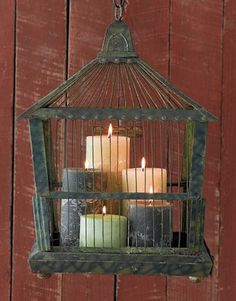 rustic birdcage with candles