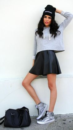 If Kylie Jenner is your style idol, you'll love this look (plus Kanye would totally approve, we think). Start with a leather circle skirt, and then add either a sweatshirt or an oversize graphic tee—the sportier the better—up top. Finish with a wordy beanie and high-top sneaks for a flirty and sassy concert outfit.
