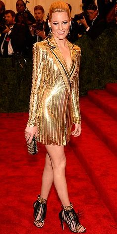ELIZABETH BANKS The actress shines bright in a plunging gold tux jacket by Atelier Versace, which she pairs with nothing but fringe Brian Atwood Elizabeth sandals (yes, they were made and named for her) at the 2013 Met Gala