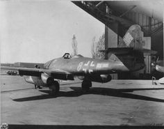 Me 262 Found Intact At Field Near Stendal, Germany, Taken By Armored Division Of The Us Army. Emblem of 'greyhound' signifies an Me 262 from JG 7 Nowotny Aircraft Photos, Ww2 Aircraft, Fighter Aircraft, Military Aircraft, Fighter Jets, Messerschmitt Me 262, Luftwaffe, Me262, Reactor