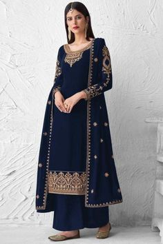 Bright and appealing, this royal blue georgette trouser suit which will personify your grace. This U-neck and full sleeve party wear trouser suit embellished in stone work and thread work. Present with santoon palazzo pant in royal blue color with royal blue georgette dupatta. Palazzo pant is plain. #trousersuit #salwarkameez #malaysia #Indianwear #Indiandresses #andaazfashion