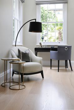 th2 Designs.© This peaceful study is the perfect place to concentrate. The two upholstered chairs add comfort to the space.