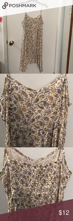 NWT H&M Spaghetti Strap Dress NWT H&M white dress with blue, purple, & yellow paisley flower pattern. Adjustable spaghetti straps, size 14, purchased in Spain. No trades. Make offers! H&M Dresses