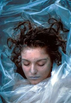 """""""Homecoming Queen Laura Palmer is found dead, washed up on a riverbank, wrapped in plastic sheeting. FBI Special Agent Dale Cooper is called in to investigate the murder of this young woman in the small, Northwestern town of Twin Peaks. What he doesn't know is that in Twin Peaks, no one is innocent"""""""