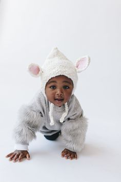 """What a great way to jump """"Baaa""""ck into the spring season with our adorable new lamb hat. Spring is here and what better way to show it by strutting your little lamb around town. This cute hat is perfect for Easter and adds a little spunk to your little cutie!"""