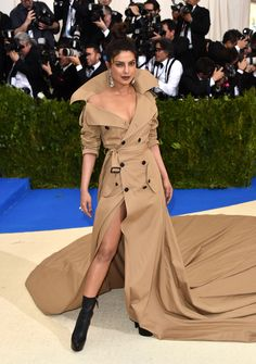 Priyanka Chopra in ralph lauren. How a trench coat is made sexy!!!
