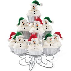 Full-of-Fun Snowmen Cupcakes - Smiling fondant snowmen top these festive winter cupcakes. This jolly group of 13 snowmen makes a fun snow scene when displayed on the Wilton Cupcakes-N-More Treat Stand. Winter Cupcakes, Christmas Cupcakes Decoration, Turkey Cupcakes, Snowman Cupcakes, Christmas Table Centerpieces, Holiday Cupcakes, Ladybug Cupcakes, Kitty Cupcakes, Giant Cupcakes