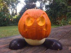 Now that's how you carve a pumpkin! Super Mario Goomba pumpkin carving by Jamie Margary via Flickr
