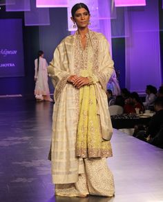 Manish Malhotra. Shaded yellow chikankari highlighted kalidar teamed with an offwhite textured pant along with a beige tussar dupatta.