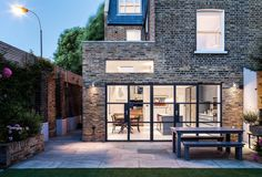 Slot House by AU Architects remodels a London end of-terrace house through the introduction of natural light, volume and the visual connection of new spaces with the existing. AUA has remodeled an end of terraced house to provide a greater Continued Las Vegas, Furniture Office, Porches, Decks, W12, Cities, Slot Machine Cake, Slot Car Tracks, Slot Cars