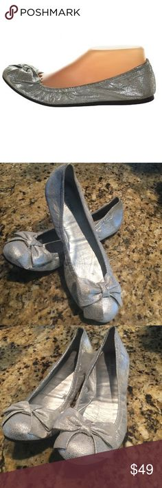Kate Spade ♠️ Silver Metallic Ballerina Shoes These preowned, eye-catching, fun, ballerina flats by Kate Spade are ideal for your summer outfits. Wear them day or night and look 👀 stunning. Add to that, comfort and style! Some minor signs of wear is evident. kate spade Shoes Slippers
