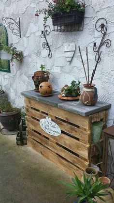 Great potting bench made from pallet and stepping stones.