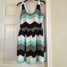 Chevron pattern dress Worn once. Flare bottom, criss-cross back, zipper up the side. Light & thin material. Perfect summer date dress! Jack. Dresses