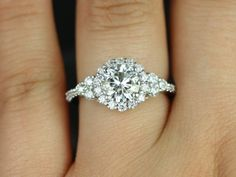 This is beautiful!!! Amora 14kt Round FB Moissanite and Diamonds Halo by RosadosBox
