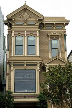 9 Scott Street, San Francisco. A more muted understated color scheme for this grand Victorian Eastlake house.