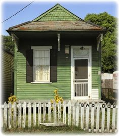 Shotgun Houses ~  narrow rectangular residence, usually no more than 12 feet wide, w/ rooms arranged one behind the other and doors at each end