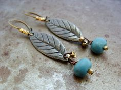 "Humblebeads Blue Leaf "" pointing to the right"" earrings."