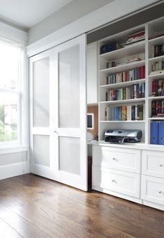 sliding door to hide crap/shelves - gives the office a nice clean look especially in open spaces when guests are expected that tend to get cluttered ^AK