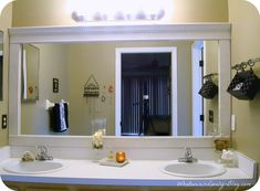 """Upgrade a builders grade bathroom mirror. Although with my bathroom, I'd have to do this in """"Cognac"""" rather than white..."""