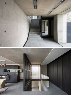 The entrance lobby of this modern house is surrounded by concrete walls and a matte black steel and bronze screen runs alongside the staircase leading to the main living level.