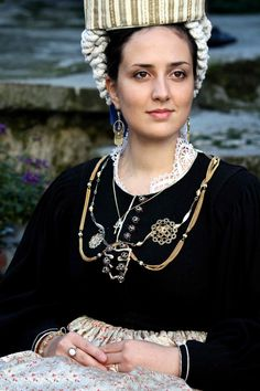 Woman wearing traditional costume and jewelry, like the famous star pendant, a.k.a. 'La Presentosa'. SCANNO(AQ) - Abruzzo, Italy.  RETREAT ACITIVITY: GUIDED TOURS OF THE HISTORIC TOWN OF SCANNO(AQ). http://www.theheartofabruzzo.it/index.php/our-retreats/activities/item/10-sightseeing