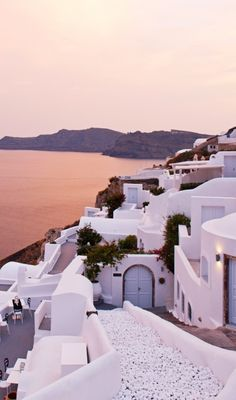 Sunset views of the caldera from every angle. Santorini, #Greece Book a trip to Greece today. Stay in a hotel or villa http://www.wimco.com/villa-rentals/europe/greece/