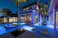 Palm trees surround the modern outdoor lounge area of this Naples, Florida, home. A heated swimming pool features sleek steppingstones, while multiple covered outdoor seating areas offer comfortable spots for hanging with family and friends. >> http://www.hgtv.com/design/ultimate-house-hunt/2017-ultimate-house-hunt/outdoor-retreats/outdoor-retreat-modern-outdoor-lounge-area