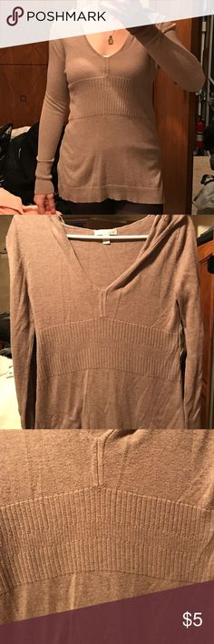 Hooded sweater Super cute and lightweight beige hooded sweater with flattering detail around the natural waist. Extra long sleeves add to comfort and long torso length makes it easy to wear with leggings. Some pilling. (See pics) Please feel free to ask questions or make an offer! New York & Company Sweaters
