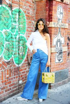 Man Repeller in flared jeans on the streets of New York City.