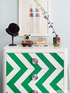 """Designer Nick Olsen amped up a Brooklyn studio apartment — just 295 square feet — by painting a flea-market chest in shiny white Rust-Oleum, with an emerald green chevron pattern. """"My motto is, 'Don't be afraid to paint,'"""" he says."""