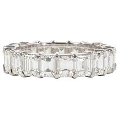 Emerald Cut Diamond Gold Eternity Band | From a unique collection of vintage band rings at https://www.1stdibs.com/jewelry/rings/band-rings/