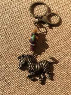 A personal favourite from my Etsy shop https://www.etsy.com/au/listing/553884973/bronze-zebra-keychain-with-african-fair