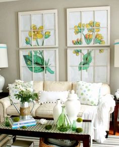 Blow up a botanic print, and place the image behind old window panes (or divide the print into equal pieces, frame each piece separately, and hang in a grid). The result is living room art that always kicks off coffee table conversations. See more at Remodelando La Casa »