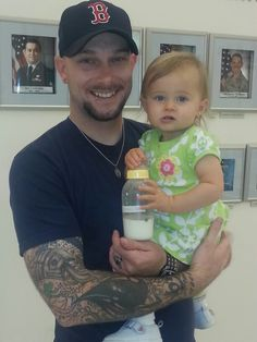 Tattooed dad with cute daughter