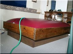 The popularity of waterbeds hit it's height in the 1970s.  It was supposedly therpuetic and enhanced sexual activity.  My experience as a kid was my uncle putting weight on one side to wake me up...he thought it was funny.  One of the troubles with it was filling it as shown above and its propensity for leaking.