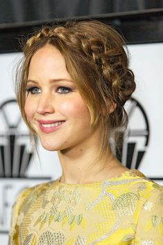 Red carpet hairstyle. Braided updo/milkmaid braid - Jennifer Lawrence. Celebrity hairstyle.
