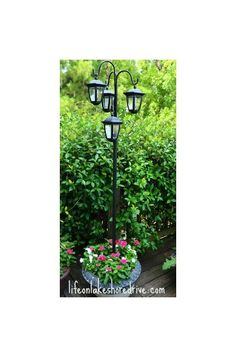 easy diy solar lights lamp post with flower planter, go green, landscape, lighting, outdoor living, I placed a steel rod in Quikrete as my base You can check out the steps on my blog