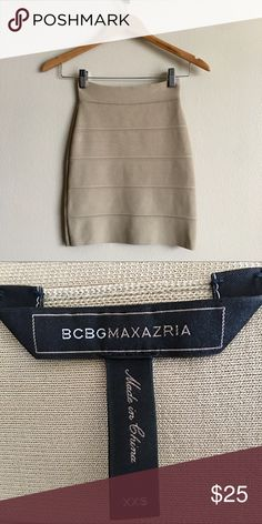 "BCBGMAXAZRIA Tan Bandage Skirt BCBGMAXAZRIA tan bandage skirt in brand new condition. I'm 5'1"" and it reached mid/lower thigh. ‼️Price is final‼️ No trades🚫 BCBGMaxAzria Skirts Midi"