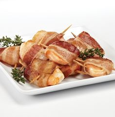 BACON WRAPPED SHRIMP. Whoever first thought of wrapping something in bacon is a genius and you'll want these at every party you throw this summer. These are a delicious option, perfect as an appetizer or side to your main course. Bacon and shrimp have a natural affinity for each other and this is perfect for socializing and catching up as these no-fuss finger foods are easy to pick up and enjoy.