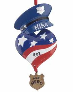 "Does a special police officer hold the key to your heart? Give him or her this red, white and blue heart ornament for Valentine's Day! The badge says ""Our Hero"" and we can personalize it with a name and a badge number. Buy it at www.ornamentshop.com for only $12.95."