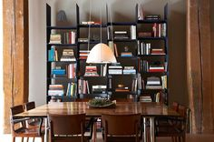 Steven Volpe Design uses a bookcase as dining room decor for this San Francisco Loft.