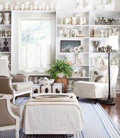 White with built in book shelves for books.  These shelves would fit perfect over the window we have. :)
