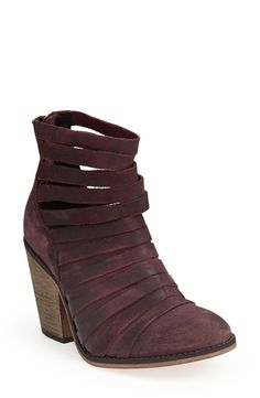 Sporting these strappy leather booties with tights and a sweater dress.