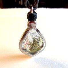 Miniature terrarium window locket with green moss and exotic map. Tear drop shape pendant.